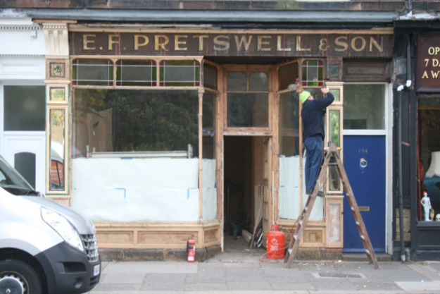 Pretswell's signage being uncovered in 2013.