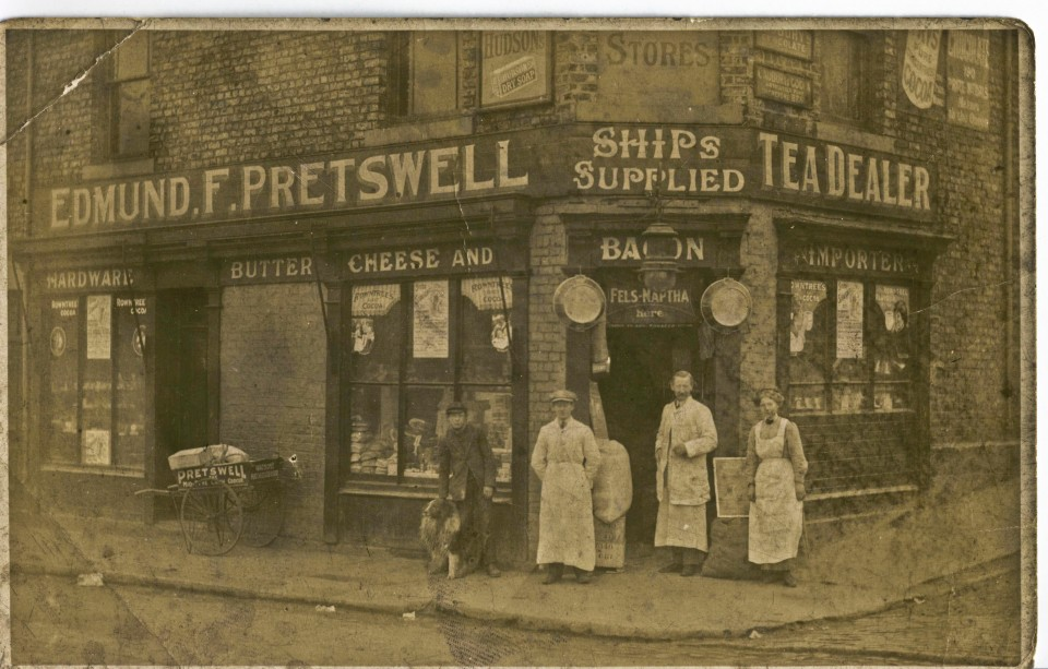 The first Edmund Forbes Pretswell with members of his family outside his Willington Quay shop
