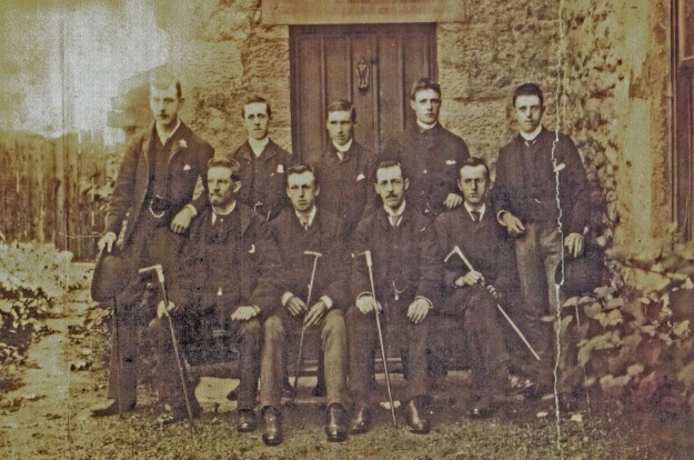 9 men outside Heaton Town Farm including members of the Edgar Family