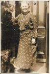 Isabella Wood at her front door in Seventh Avenue, still tending plants